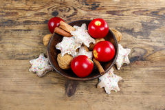 Bowl of christmas sweets on wooden table Stock Image