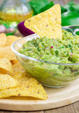 Bowl with chunky guacamole served with nachos Royalty Free Stock Images