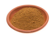 Bowl of cinnamon spice on a white background Stock Image