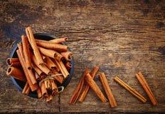 Bowl of cinnamon sticks Stock Photo