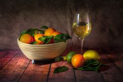 A bowl of citrus fruit and wine royalty free stock photos
