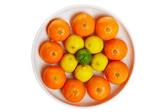Bowl of citrus fruits isolated on a white Stock Photo