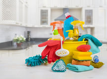 Bowl with cleaning products on table over blurred kitchen background Stock Photos