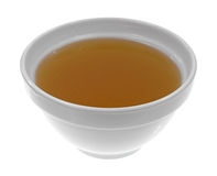 Bowl of clear chicken broth Stock Images