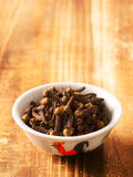 Bowl of cloves Stock Photography