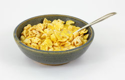 Bowl Coated Flake Cereal. An appetizing view of breakfast cereal with a spoon Royalty Free Stock Photo