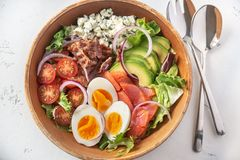 Bowl of Cobb salad. On the table: top view royalty free stock images