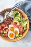 Bowl of Cobb salad. On the table: top view royalty free stock photo