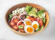 Bowl of Cobb salad. On the table: top view stock photo