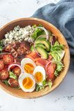 Bowl of Cobb salad. On the table: top view royalty free stock photography