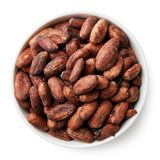 Bowl of cocoa beans stock photography