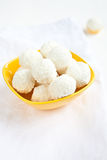 Bowl with coconut balls Royalty Free Stock Photos