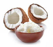 Bowl of coconut oil and fresh coconuts. Isolated on white Stock Images