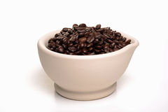 Bowl of coffee beans. Photograph of coffee beans in a bowl shot in studio against a white background Stock Photos