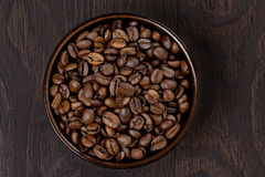 Bowl of coffee beans on a dark background, top view Royalty Free Stock Image