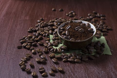 Bowl with coffee beans and ground coffee Stock Photo