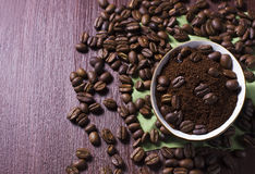 Bowl with coffee beans and ground coffee Stock Photos