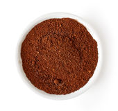 Bowl of coffee powder isolated on white, from above Stock Image
