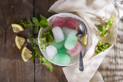 Bowl of colored ice-cubes Stock Image