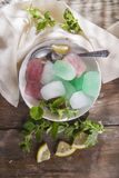 Bowl of colored ice-cubes Royalty Free Stock Photography