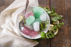 Bowl of colored ice-cubes Royalty Free Stock Photos