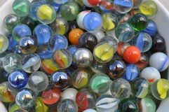 Bowl of colorful glass marbles Royalty Free Stock Photo