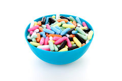 Bowl with colorful laces rods candy Stock Photo