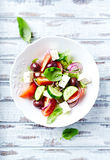 Bowl of colorful summer salad with feta and olives Royalty Free Stock Photos