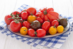 Bowl with colorful tomatoes. Enamel bowl with colorful tomatoes Stock Photos