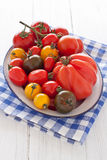 Bowl with colorful tomatoes. Enamel bowl with colorful tomatoes Royalty Free Stock Image