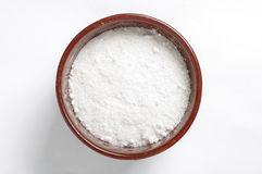 A bowl of common salt  on the bright background Stock Photography
