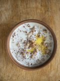 Bowl of cooked buckwheat with milk and run butter stock image