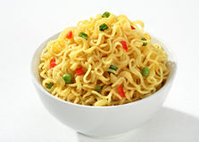 Bowl with cooked noodles Stock Images