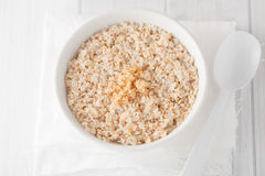 A bowl of cooked oatmeal with brown sugar Stock Photography