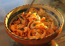 Bowl of cooked prawns stock image