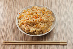 Bowl of cooked rice with chopsticks Royalty Free Stock Image