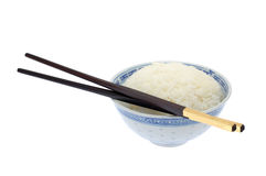 Bowl of cooked rice with chopsticks Stock Photo