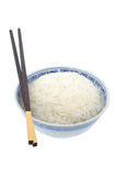 Bowl of cooked rice with chopsticks Royalty Free Stock Photo