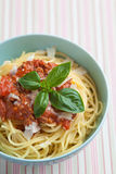Bowl of cooked spaghetti with tomato sauce and basil Stock Image