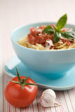Bowl of cooked spaghetti with tomato sauce and basil Stock Photos