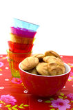 Bowl with cookies and a stack of glasses Royalty Free Stock Photos