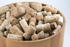 Bowl of corks. Display of old wine and champagne corks in a wooden fruit bowl royalty free stock images