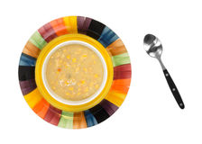 Bowl of corn chowder with spoon Stock Image