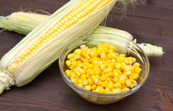 Bowl of corn cobs and wood Royalty Free Stock Image