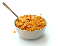 Bowl of corn flake cereal with a spoon Royalty Free Stock Images