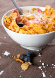 Bowl of corn flakes and berries Royalty Free Stock Image