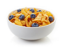 Bowl of corn flakes and blueberries isolated on white. Background Stock Image