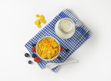 Bowl of corn flakes and jug of milk Royalty Free Stock Photo