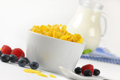 Bowl of corn flakes and jug of milk Stock Images