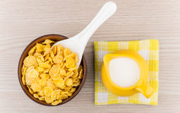 Bowl with corn flakes and jug of milk on napkin Royalty Free Stock Image